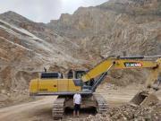 高效率、低成本,听20年老牌矿山企业说说徐工挖机