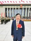 """谭旭光被授予""""全国优秀共产党员""""称号"""