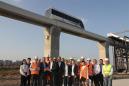 德国巴伐利亚州代表团调研新筑股份内嵌式中低速磁浮试验线项目建设情况